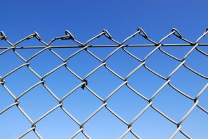 Chain link fence with blue sky background