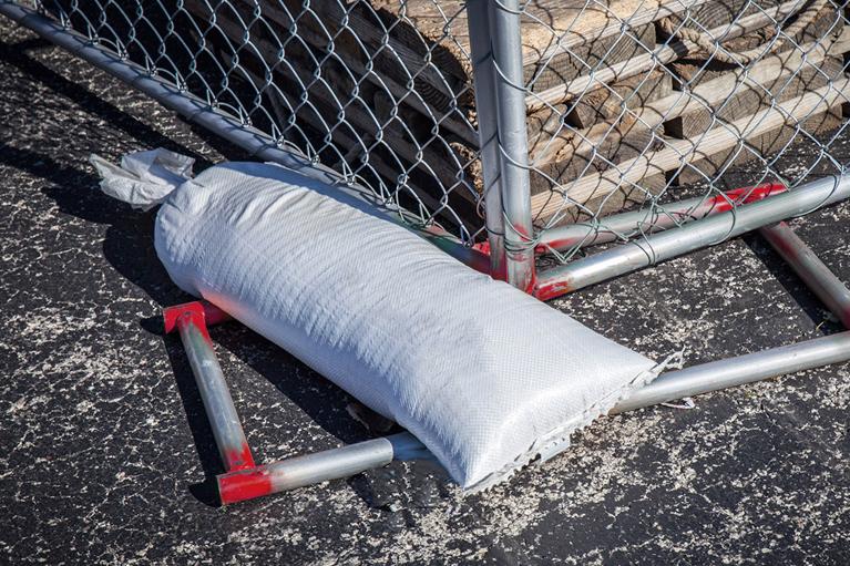 sandbag on temp fence